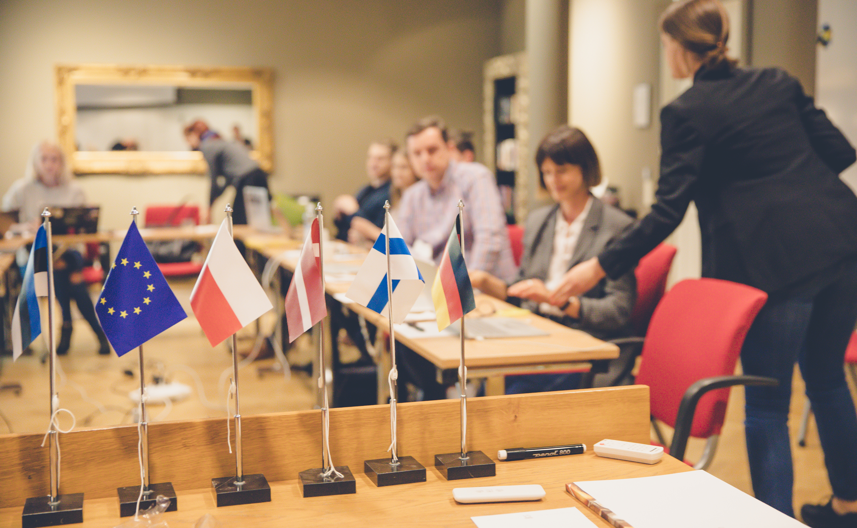 People in conference room with flags